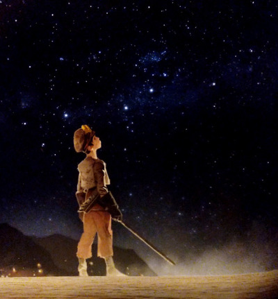 A fantasy-style drawing of a young boy, dressed in dirty brown clothes and holding a broom, looking up at the night sky filled with stars.